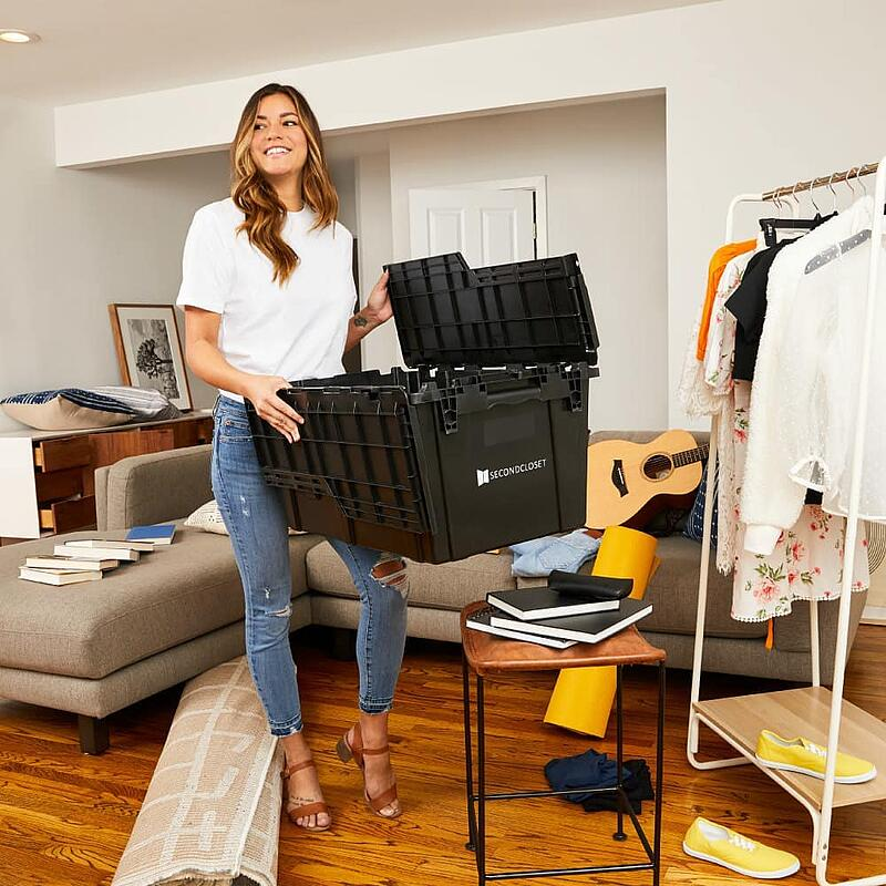 woman using second closet boxes to pack items